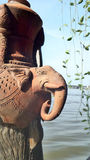 Elephant Clay aculpture on wooden post Royalty Free Stock Images