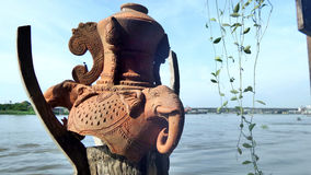 Elephant Clay aculpture on wooden post Stock Photos