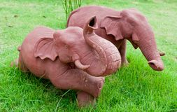 Elephant clay dolls in the garden , Royalty Free Stock Images