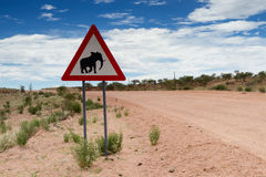 Elephant crossing sign on a gravel road Royalty Free Stock Photography