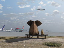 Elephant and dog at the airport. Elephant and dog sitting at the airport Royalty Free Stock Photos