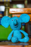Elephant doll on a wood desk Royalty Free Stock Photo