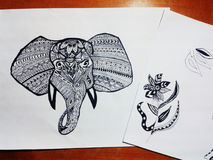 Elephant drawing. Doodles with zentangle patherns of a elephant and a flower stock images