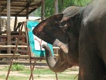Elephant draws a tree a trunk Royalty Free Stock Photography