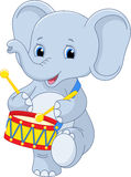 Elephant drummer. Small elephant marching and Drumming Royalty Free Stock Image