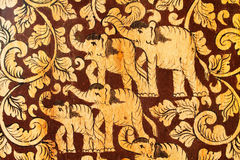 Elephant Family pattern. With leaves on wood stock photo