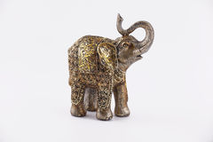 Elephant. Figure of elephant in gold and brown color Royalty Free Stock Image