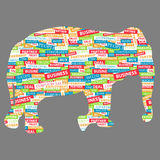Elephant figurine, made up of words on a business Stock Photos
