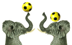 Elephant Figurines with Soccer Balls Stock Photo