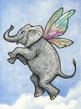 Elephant Flying. Elephant with fairy wings flying in a clouded blue sky Royalty Free Stock Images