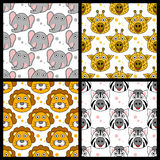 Elephant Giraffe Lion Zebra Seamless. A collection of four seamless patterns with funny cartoon animal faces (elephant, giraffe, lion and zebra),  on white Stock Image
