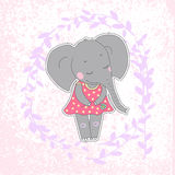 Elephant girl with closed eyes having flower in her hand. Lovely elephant calf in a dress in peas on on background with branches and texture Stock Images