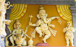 Elephant God Ganesh Statue. In orange and yellow Stock Image