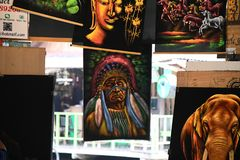 Painted gallery photographs at pattaya floating market. Elephant and green trees painted photographs at pattaya floating market royalty free stock photo