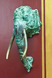 The elephant head is a door handle in the temple. Royalty Free Stock Photography