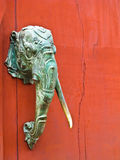 Elephant head statue. Attached on the red wood door Stock Image