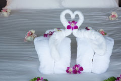 Two elephant and heart made from towels on honeymoon bed. Royalty Free Stock Photography