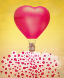 Elephant in a heart shaped balloon in the sky. Royalty Free Stock Images