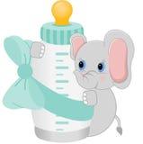 Elephant holding baby bottle it`s a boy Stock Image