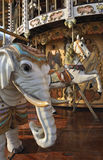 Elephant and horse on fairground carousel. The carousel is of French origin from the early 1900's Stock Image