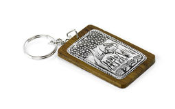 Elephant keychain on wood isolated on white background Royalty Free Stock Photos
