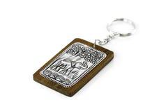Elephant keychain on wood isolated on white background Stock Images