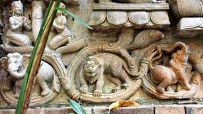 Elephant Lion demon mould terracotta. Demon intimidate  Lion two elephants ivy mold Sculpture  terracotta ancient story Stock Photography