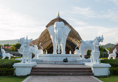 Elephant and Lion statues. White Elephant and White Lion statues in front of Chiangmai Night Safari stock photography