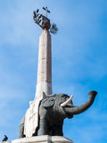 Elephant made of lavic stone. The obelisk with the black elephant, made of lavic stone, is the symbol of Catania Stock Photos