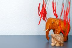 Figure of an elephant made of wood under the branches stock image