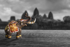 An elephant model on black and white background. An elephant model dressing with Thai kingdom tradition accessories royalty free stock photo