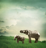 Elephant mother and child. Together in fantasy hill royalty free stock image