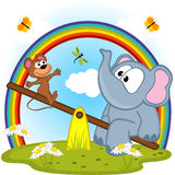 Elephant and mouse riding on seesaw Stock Images