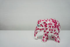 Elephant paperweight with pink painting. Isolated elephant paperweight with pink painting Stock Photos