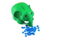 Elephant piggy bank and tablets Royalty Free Stock Photo