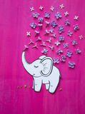 Elephant pours water. Illustration applique of flowers and paper stock photo