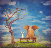 Elephant and rabbit sit on a bench Royalty Free Stock Image