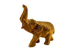 Elephant with a raised trunk carved out of wood. Isolated on background white Royalty Free Stock Image