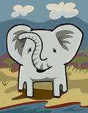 Elephant at a River. Front view of an elephant grazing near a river through an African grassland Stock Image