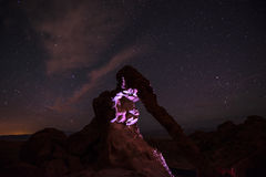Elephant Rock at Night lit by a flashlight against bright starry Royalty Free Stock Photos