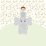 Elephant rolls a little boy. Royalty Free Stock Photos