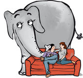 Elephant in room2. An elephant behind a couple sitting on sofa Stock Photo
