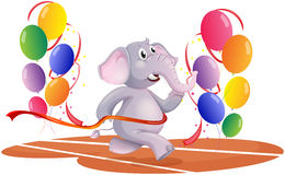 An elephant running with balloons Stock Photo