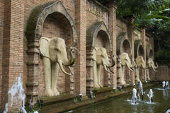Elephant sculpture on brick wall Stock Image