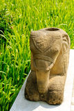 Elephant sculpture on rice field background Stock Photography