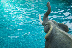 Elephant sculpture showing trunk beside swimming pool Royalty Free Stock Photography