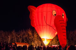 Elephant Shaped Glowing Hot Air Balloon. Elephant shaped hot air balloon lit up at night during a festival Royalty Free Stock Image