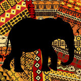 Elephant silhouette on ethnic textures background Stock Photos