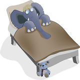 Elephant sleeping in a bed Royalty Free Stock Images