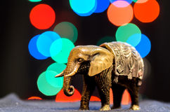 Elephant. A small decorative statuette of elephant with color bokeh Stock Image